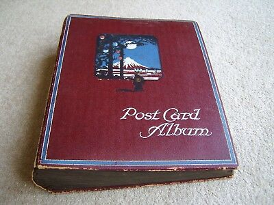 Old postcard album with Japan scene to cover, stores cards by their corner tips