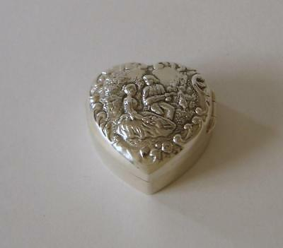 An Ornately Embossed Sterling Silver Heart Shaped Pill Box Sheffield 2000