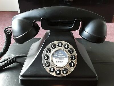 next retro telephone, full working order, looks great, decorators item ?