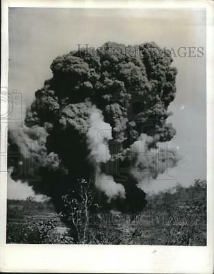 1942 Press Photo New Guniea, delayed action bomb blast at UN base - neb73351