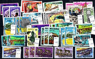A SELECTION OF STAMPS FROM NIGERIA ON A STOCK CARD 1960s START.