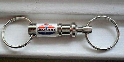 Amoco Key Chain -- One key chain that you can separate into two -- Amoco Logo