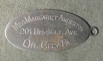 Identification Tag Engraved: Oil City PA Miss Margaret Anderton 201 Bissell Ave