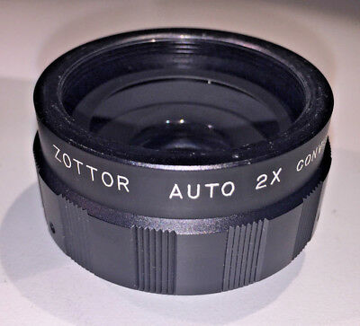 A classic Zottor Auto 2x teleconverter, M42 screw thread mount, with case