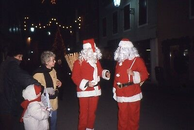 35mm SLIDE : AMERICAN TWO FATHER CHRISTMAS STANDING ON A STREET CORNER 1999