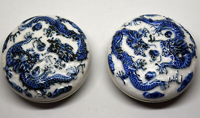 Chinese Pair of Blue and White Porcelain Embossed Dragon Paste/Trinket Box Set