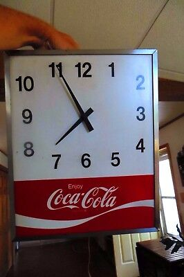 vintage metal cased and metal faced enjoy coca cola  electric working clock