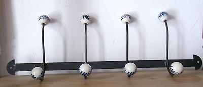 Wall Coat Rack Made of Cast Iron with Blue White Porzelanknöpfen