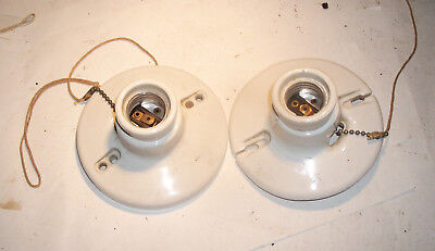 Pair of old porcelain pull chain light fixtures USA