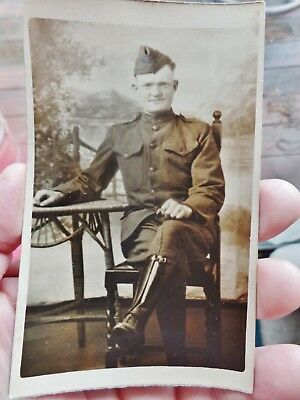RPPC real photo post card WWI soldier doughboy seated on chair