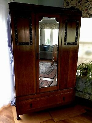 Antique Solid Oak Wardrobe beautiful condition. Brought back from England.