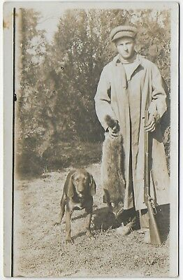 (#3010) Old RPPC Young Man with Lever Action Rifle Holds Dead Fox by Hunting Dog