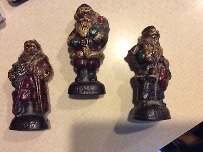 3 Antique Cast Iron Santa Claus 1908 1909 1925 Christmas doorstop paperweight