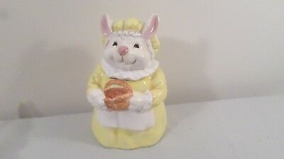 "9 3/4"" Ceramic Rabbit Cookie Jar holding basket"