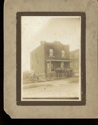 photograph-family & a soldier & a building
