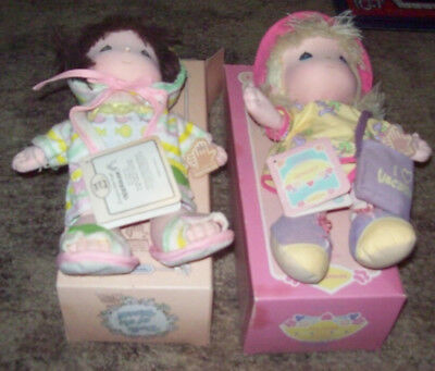 2 Precious Moments cloth dolls of the Month August