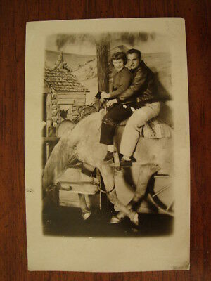 Old Vintage Souvenir Rppc Photo Postcard Man Woman On Bucking Bronco Horse Prop