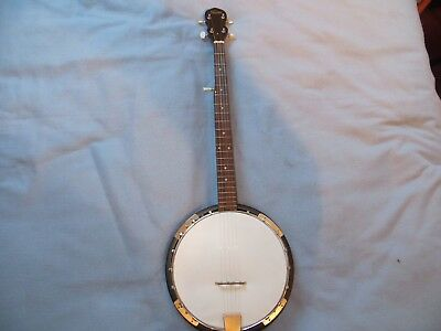5 string banjo made by Swift in good playing condition