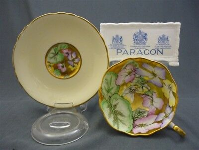 WIDE Paragon Bone China Yellow Heavy Gold HAND PAINTED Flowers Tea Cup & Saucer
