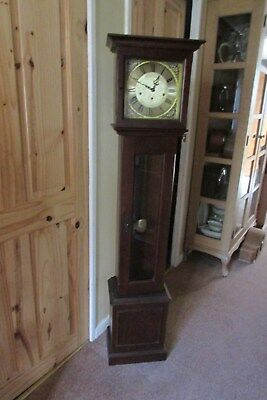 Brass faced flat topped grandmother clock with westminster chimes /silent