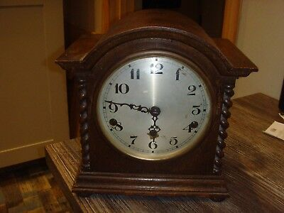 Arch top wooden case westminster chime mantle clock