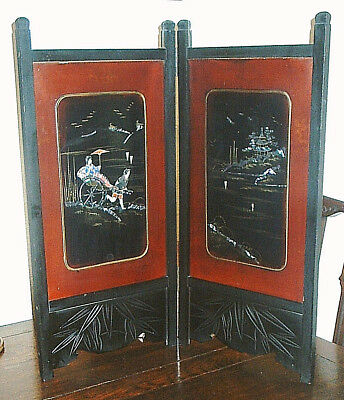 Antique Oriental Bifold Ebonised Wood Screen with Red Laquered Decorated Panels