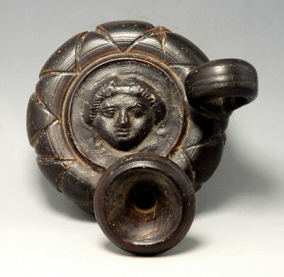 Greek South Italian Terracotta Black-Glazed Guttus Depicting Apollo (M137)