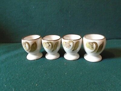 Four Denby Troubador egg cups.