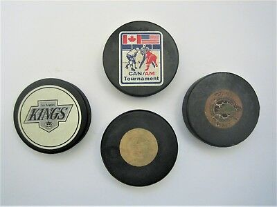 Vintage Hockey Pucks - Lot Of Four Collectible Professional Hockey Pucks