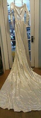 Vintage 1950s satin wedding gown with long train and satin covered buttons ivory
