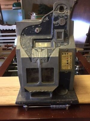 Antique slot machine with new decals for reals and displays