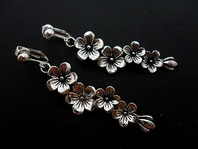 A Pair Of Long Dangly Tibetan Silver Flower Themed Clip On Earrings. New.