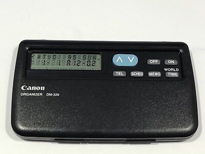 Vintage canon electronic organizer & calculator DM 320 works well