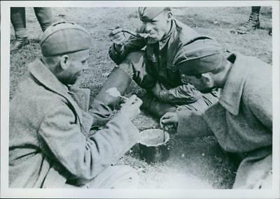 Prisoners sharing a meal in Annowka concentration camp. - Vintage photo