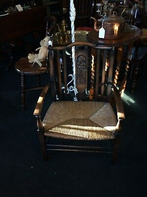 Antique Victorian Carved Oak Nursing Chair with Rush Seat