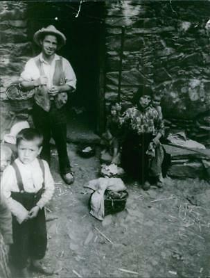 Family members ready to go to market in Spain. - Vintage photo