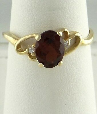 LADIES 10K YELLOW GOLD 1 1/2ct OVAL SYNTHETIC GARNET JANUARY HEART RING