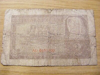 A 1941 or 42 Poland 2 Zlotych Banknote - Used folds and dirty marks Tatty note