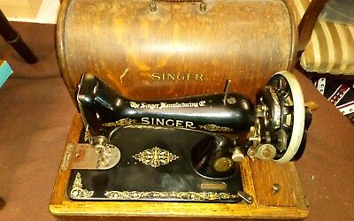 Used black and gold vintage manual hand crank Singer sewing machine with key