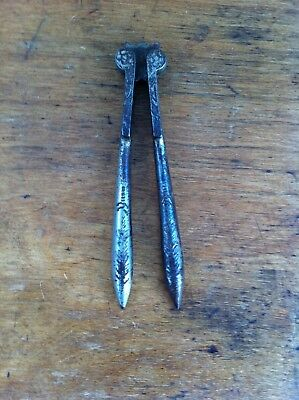 DECORATIVE PAIR of ANTIQUE PLATED CUT STEEL NUTCRACKERS  5.1 inches