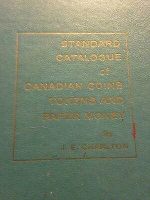 8 volumes of Standard Catalogue Canadian Coins Tokens & Paper Money by Charlton