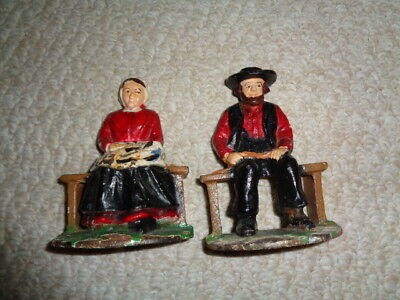 Cast iron hand painted dutch lady man book ends sitting wooden bench green grass