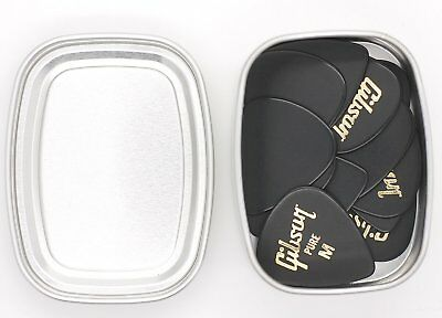 12 Gibson Pure M Medium Celluloid Guitar Picks Plectrums In A Metal Storage Tin