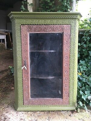 Antique oak glass-fronted corner cupboard with carved decoration
