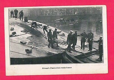 Capsizing of the Steamship Eastland Chicago Firemen Remove a Body 1915 RPPC