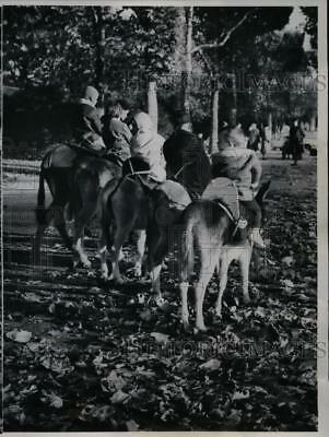 1962 Press Photo Children Ride Donkeys Along Promenades of Paris Champs Elysees