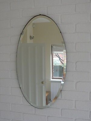 Antique victorian oval mirror with bevelled glass
