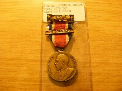 A LCC George V Kings Medal with ribbon + Bar, nice condition - 30mm Dia