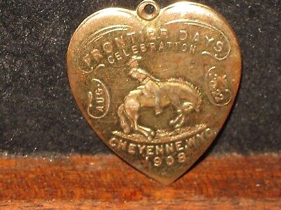 Antique 1903 Frontier Days Cheyenne WY Cowboy Horse Brass Heart Medal Charm