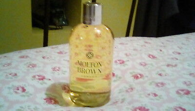 Molton Brown cardamon & cederwood 300 ml bath and shower gel.